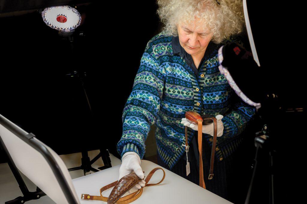 Linda Newington with knitting belts at Shetland Textile Museum